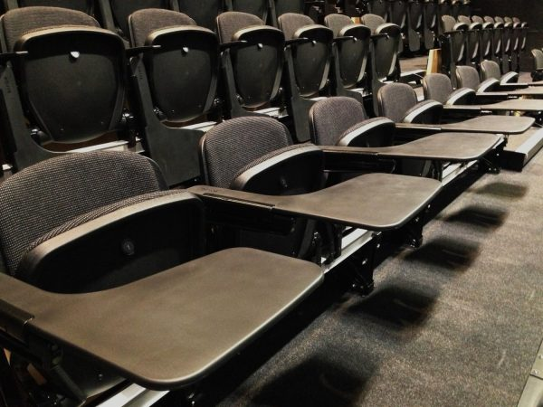 lecture seating retractable seating with writing tablet